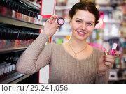 Купить «happy woman customer deciding on make-up items in cosmetics shop», фото № 29241056, снято 21 февраля 2017 г. (c) Яков Филимонов / Фотобанк Лори