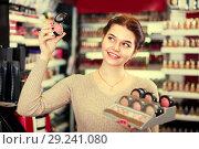 Купить «Young female client is searching for reliable blushes», фото № 29241080, снято 21 февраля 2017 г. (c) Яков Филимонов / Фотобанк Лори