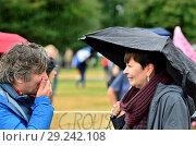 Купить «Martin Hughes-Games - BBC nature presenter - and Caroline Lucas MP (Green, Brighton) talking in Hyde Park before the People's Walk for Wildlife, London, 22nd Sept 2018.», фото № 29242108, снято 22 сентября 2018 г. (c) age Fotostock / Фотобанк Лори