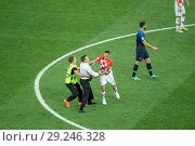 Купить «Pitch invaders storm onto the pitch during the 2018 FIFA World Cup Final between France and Croatia. Croatian centre back Dejan Lovren attempted to grab...», фото № 29246328, снято 15 июля 2018 г. (c) age Fotostock / Фотобанк Лори