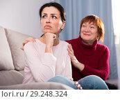 Купить «Mature female consoling daughter at sofa after quarrel», фото № 29248324, снято 23 ноября 2017 г. (c) Яков Филимонов / Фотобанк Лори