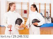 Купить «Active young women fencers in uniform talking at fencing room», фото № 29248532, снято 11 июля 2018 г. (c) Яков Филимонов / Фотобанк Лори