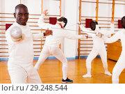 Купить «African american man fencer in training room», фото № 29248544, снято 11 июля 2018 г. (c) Яков Филимонов / Фотобанк Лори