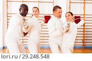 Купить «Men and women fencers posing with foils together at fencing workout», фото № 29248548, снято 11 июля 2018 г. (c) Яков Филимонов / Фотобанк Лори