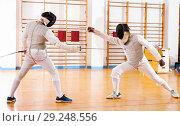 Купить «Portrait of athletes at fencing workout, practicing attack movements in duel», фото № 29248556, снято 11 июля 2018 г. (c) Яков Филимонов / Фотобанк Лори