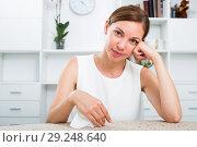 Купить «woman sitting lonely indoors», фото № 29248640, снято 18 октября 2018 г. (c) Яков Филимонов / Фотобанк Лори