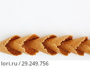 Several waffle cones lined in tower, smile, or even row, top vie. Стоковое фото, фотограф Tetiana Chugunova / Фотобанк Лори