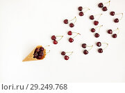 Купить «Waffle cone with fresh cherry berries, top view, isolated on whi», фото № 29249768, снято 18 июня 2017 г. (c) Tetiana Chugunova / Фотобанк Лори