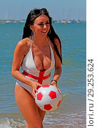 Купить «Ex Voice star the gorgeous Lydia Lucy goes all patriotic on the beach at Leigh on Sea Essex n her England themed bikini earlier today. Featuring: Voice...», фото № 29253624, снято 26 июня 2018 г. (c) age Fotostock / Фотобанк Лори
