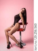 Купить «Fashion portrait of a pretty young woman wearing makeup dressed in bodysuit», фото № 29256560, снято 4 октября 2018 г. (c) Restyler Viacheslav / Фотобанк Лори