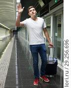 Купить «Man with luggage bag in subway station», фото № 29256696, снято 24 августа 2018 г. (c) Яков Филимонов / Фотобанк Лори