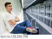 Купить «Passenger sitting on seat in subway carriage», фото № 29256700, снято 24 августа 2018 г. (c) Яков Филимонов / Фотобанк Лори