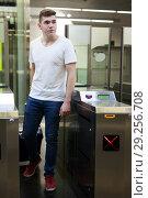 Купить «Man passing baffle gate in metro station», фото № 29256708, снято 24 августа 2018 г. (c) Яков Филимонов / Фотобанк Лори