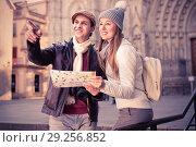 Купить «Man and woman with map and package looking attraction outdoors», фото № 29256852, снято 18 ноября 2017 г. (c) Яков Филимонов / Фотобанк Лори