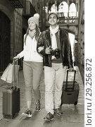 Купить «Couple walking with luggage», фото № 29256872, снято 18 ноября 2017 г. (c) Яков Филимонов / Фотобанк Лори