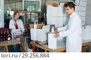 Купить «Man standing in packing section on winemaking factory», фото № 29256884, снято 21 сентября 2016 г. (c) Яков Филимонов / Фотобанк Лори