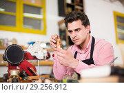 Купить «Craftsman in uniform working in carpentry», фото № 29256912, снято 8 апреля 2017 г. (c) Яков Филимонов / Фотобанк Лори