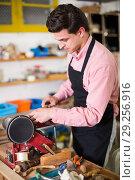 Купить «Craftsman working on woodworking machine», фото № 29256916, снято 8 апреля 2017 г. (c) Яков Филимонов / Фотобанк Лори