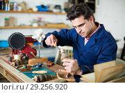 Купить «Joiner working in workshop», фото № 29256920, снято 8 апреля 2017 г. (c) Яков Филимонов / Фотобанк Лори