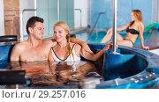 Купить «Woman with man are talking in pool», фото № 29257016, снято 18 июля 2017 г. (c) Яков Филимонов / Фотобанк Лори