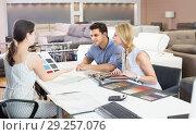 Купить «Couple wit seller consulting about color for new sofa», фото № 29257076, снято 19 июня 2017 г. (c) Яков Филимонов / Фотобанк Лори