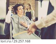 Купить «Angry woman telling to hairdresser that she does not like her hairstyle», фото № 29257168, снято 7 марта 2017 г. (c) Яков Филимонов / Фотобанк Лори