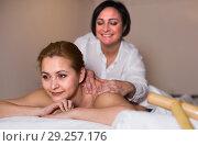 Купить «Girl is happy with procedure massage in beauty parlor», фото № 29257176, снято 7 марта 2017 г. (c) Яков Филимонов / Фотобанк Лори