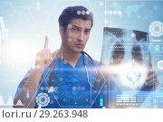 Купить «Doctor looking at x-ray image in telehealth concept», фото № 29263948, снято 26 марта 2019 г. (c) Elnur / Фотобанк Лори