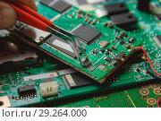 Купить «Printed Circuit Board with many electrical components», фото № 29264000, снято 25 сентября 2018 г. (c) Максим Бейков / Фотобанк Лори