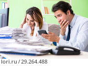 Купить «Two financial specialists working in the office», фото № 29264488, снято 11 июня 2018 г. (c) Elnur / Фотобанк Лори