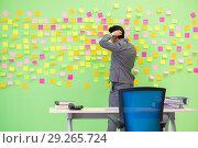 Купить «Businessman with many conflicting priorities», фото № 29265724, снято 24 мая 2018 г. (c) Elnur / Фотобанк Лори