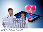 Купить «Telemedicine concept with remote monitoring of heart condition», фото № 29270824, снято 17 декабря 2018 г. (c) Elnur / Фотобанк Лори