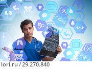 Купить «Doctor looking at x-ray image in telehealth concept», фото № 29270840, снято 26 марта 2019 г. (c) Elnur / Фотобанк Лори