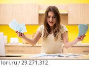 Купить «Young woman wife in budget planning concept», фото № 29271312, снято 12 июня 2018 г. (c) Elnur / Фотобанк Лори
