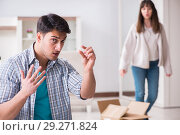Купить «Woman evicting man from house during family conflict», фото № 29271824, снято 23 марта 2018 г. (c) Elnur / Фотобанк Лори