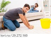 Купить «Young family doing cleaning at home», фото № 29272160, снято 6 октября 2016 г. (c) Elnur / Фотобанк Лори