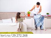 Купить «Man ironing, his lazy wife sitting», фото № 29272268, снято 27 июня 2018 г. (c) Elnur / Фотобанк Лори