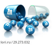 Купить «Capsule with zinc Zn element. Dietary supplements. Vitamin capsule isolated on white.», фото № 29273032, снято 17 июля 2019 г. (c) Maksym Yemelyanov / Фотобанк Лори