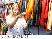 Купить «woman expressing displeasure with quality and price of jacket», фото № 29274108, снято 5 сентября 2018 г. (c) Яков Филимонов / Фотобанк Лори