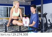 Купить «Girl doing push-ups with trainer», фото № 29274308, снято 16 июля 2018 г. (c) Яков Филимонов / Фотобанк Лори