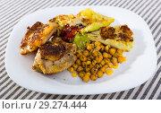 Купить «Fried chicken thighs with breaded cabbage, chickpeas, sauces», фото № 29274444, снято 19 января 2019 г. (c) Яков Филимонов / Фотобанк Лори