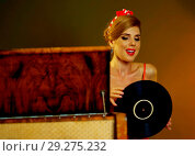 Купить «Dj retro woman vintage vinyl turntable music. Girl pin-up style wearing red dress.», фото № 29275232, снято 12 декабря 2018 г. (c) Gennadiy Poznyakov / Фотобанк Лори