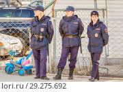 Купить «Russia, Samara, April 12, 2016: female police officers stand in the park and monitor the order in a public place on a sunny day.», фото № 29275692, снято 12 апреля 2016 г. (c) Акиньшин Владимир / Фотобанк Лори