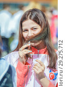 Купить «Russia, Samara, April 12, 2016: a young beautiful girl dressed with space theme, on holiday, Cosmonautics Day, in the square with a space rocket, on a spring sunny day.», фото № 29275712, снято 12 апреля 2016 г. (c) Акиньшин Владимир / Фотобанк Лори