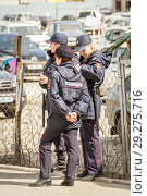 Купить «Russia, Samara, April 12, 2016: female police officers stand in the park and monitor the order in a public place on a sunny day.», фото № 29275716, снято 12 апреля 2016 г. (c) Акиньшин Владимир / Фотобанк Лори