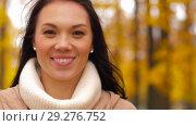 Купить «beautiful happy young woman smiling in autumn park», видеоролик № 29276752, снято 18 октября 2018 г. (c) Syda Productions / Фотобанк Лори
