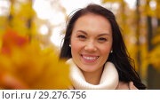 Купить «happy young woman with leaves in autumn park», видеоролик № 29276756, снято 18 октября 2018 г. (c) Syda Productions / Фотобанк Лори