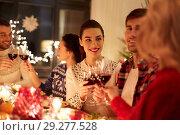 Купить «happy friends celebrating christmas at home feast», фото № 29277528, снято 17 декабря 2017 г. (c) Syda Productions / Фотобанк Лори