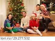 Купить «friends celebrating christmas at home», фото № 29277532, снято 17 декабря 2017 г. (c) Syda Productions / Фотобанк Лори