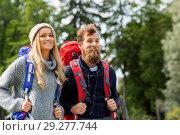 Купить «couple of travelers with backpacks hiking», фото № 29277744, снято 31 августа 2014 г. (c) Syda Productions / Фотобанк Лори